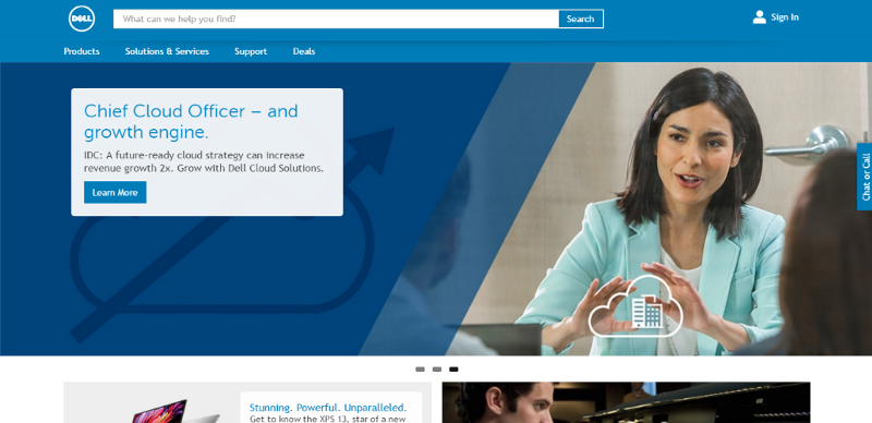 Don't. There's simply no next / previous carousel controls on the Dell's homepage. Navigation option is given to the small dots located below the carousel.